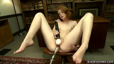 Solo ginger babe fucks machine on table