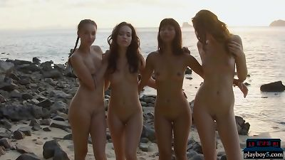 Four pretty lesbian girlfriends get naked on the beach