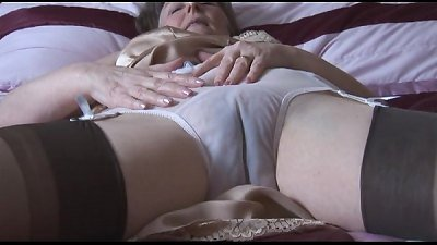 hairy granny in glide and pantyhose with watch thru panties undresses
