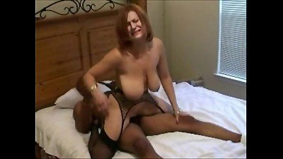 fertile white slut in black stockings gets black bred